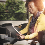 African Woman Using Tablet Relaxation Concept.  royalty free stock images