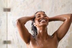 Free African Woman Washing Hair Under Shower Stock Image - 159265711