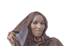 African woman wearing a traditional headscarf, isolated. African woman wearing a traditional headscarf,  isolated Royalty Free Stock Photo