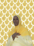 African woman wearing a yellow cotton veil Royalty Free Stock Photos