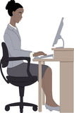 African woman working on computer. Young African lady in smart grey office suit sitting with good posture on an office chair typing on a desktop computer Royalty Free Stock Photo
