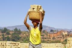 Africans woman working hard in brickyard. African woman working hard in brickyard - Madagascar stock photos