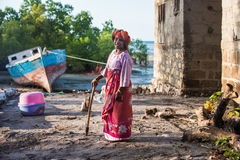 African woman in Zanzibar. Even facing severe life conditions, people in rural Africa are joyful and optimistic Royalty Free Stock Image
