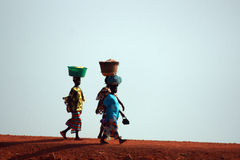 African women. Returning from work in the fields stock image
