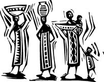 African Women. Traditional African textile design with women carrying baskets Stock Photos
