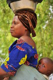African women with baby on the back. In village Niger, West Africa Royalty Free Stock Images