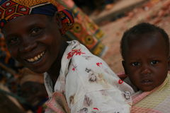 African women carrying  children Stock Photo