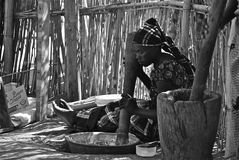 African Women Coocking. African women cooking outdoor on the floor in a village in south in Sud Africa Stock Image