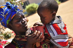 African women feeding child Royalty Free Stock Photography