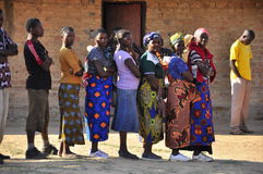 African women queuing to vote at polling station Stock Photos