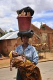 African women at work. African women carrying basket with food on the head and baby in her arms, Madagascar, Africa Royalty Free Stock Photography