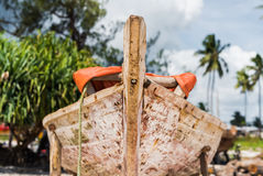 African wooden boat stern with palms and sky on the background Stock Photo