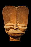 African wooden mask. Isolated on black Stock Photos