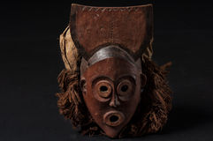 African wooden mask with hair, isolated Royalty Free Stock Photo