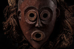 African wooden mask with hair, isolated Stock Photos