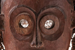 African wooden mask with hair, isolated Royalty Free Stock Photography