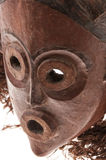 African wooden mask with hair, isolated Stock Images
