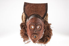 African wooden mask with hair, isolated Stock Image