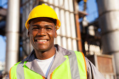 African worker petrochemical. Happy young african worker in petrochemical plant Stock Photography