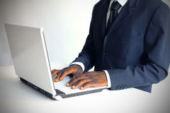 African working on pc Royalty Free Stock Photography