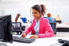 African young businesswoman working in office. With computer Stock Photography