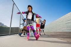 African girl rollerblading with hands like wings Royalty Free Stock Photography
