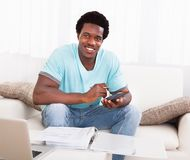 African young man calculating Stock Photo