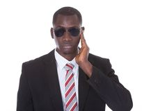 African young man with hand on ear stock images