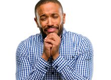 African young man isolated over white background. African american man with beard crying depressed full of sadness expressing sad emotion isolated over white Stock Image