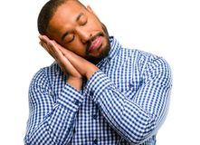 African young man isolated over white background. African american man with beard tired and bored, tired because of a long day overworking isolated over white Stock Images