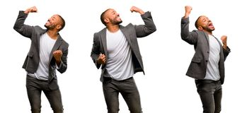 African young man over white background. African american man with beard happy and excited celebrating victory expressing big success, power, energy and positive Royalty Free Stock Photos