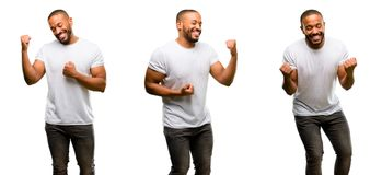 African young man over white background. African american man with beard happy and excited celebrating victory expressing big success, power, energy and positive Stock Photography