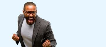 African young man  over white background. African american man with beard happy and excited celebrating victory expressing big success, power, energy and Royalty Free Stock Image