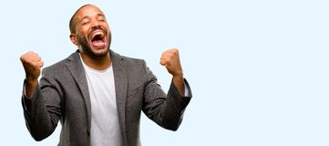 African young man over white background. African american man with beard happy and excited celebrating victory expressing big success, power, energy and positive stock image
