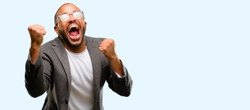 African young man  over white background. African american man with beard happy and excited celebrating victory expressing big success, power, energy and Stock Photography