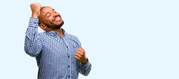 African young man over white background. African american man with beard happy and excited expressing winning gesture. Successful and celebrating victory Stock Photos