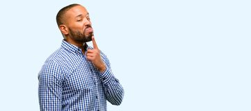African young man over white background. African american man with beard having skeptical and dissatisfied look expressing Distrust, skepticism and doubt over royalty free stock photo