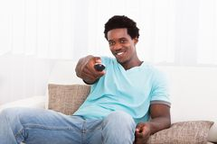 African young man watching television Stock Photos