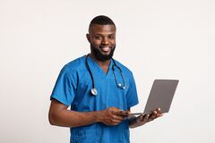 African young therapist in unifrom holding laptop