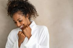 Free African Young Woman In Bath Robe At Spa Stock Photos - 159265533