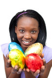 African young woman showing colorful Easter eggs Royalty Free Stock Photo