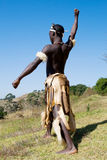 African zulu dancer. South African zulu tribe man dressed in traditional clothes dancing on wild mountain Royalty Free Stock Photo