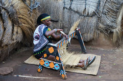 African Zulu woman wearing traditional handmade costume weave st. Lesedi Cultural Village, South Africa - 20 October 2016: Unidentified African Zulu woman royalty free stock photography