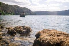 Africans in canoe on beautiful Chala lake, Kenya and Tanzania bo Royalty Free Stock Images