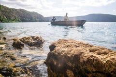 Africans in canoe on beautiful Chala lake, Kenya and Tanzania bo Royalty Free Stock Image