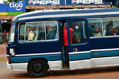 Africans people are traveling in the cabin blue local bus. Makuyuni, Arusha, Tanzania - February 11, 2008: africans people are traveling in the cabin dark blue stock image