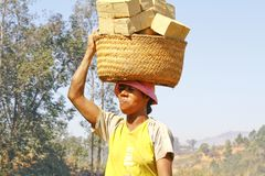 Africans woman working hard in brickyard. African woman working hard in brickyard - Madagascar royalty free stock images