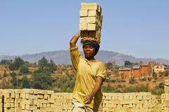 Africans woman working hard in brickyard. African woman working hard in brickyard - Madagascar royalty free stock photos