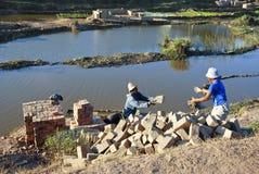 Africans working hard in brickyard. Madagascar stock photo