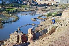Africans working hard in brickyard. Madagascar stock photography